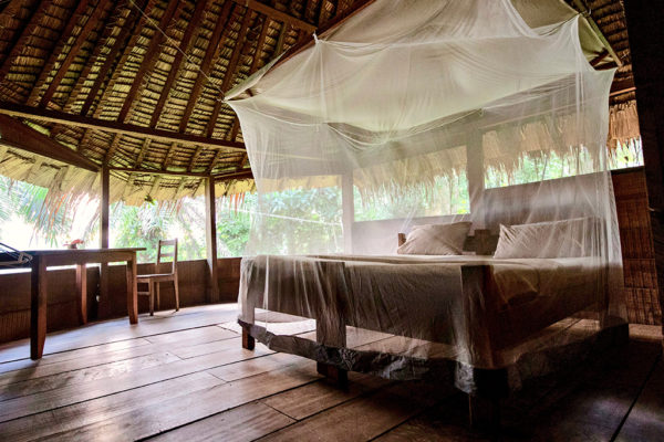 congo-conservation-company-sangha-lodge-chalet-bed